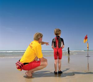RNLI lifeguard offering safety advice